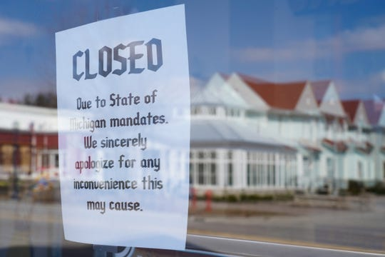 Signs are posted for closure on the doors of the Bavarian Inn as businesses along S. Main St. in Frankenmuth remain closed on March 25, 2020, due to the stay-at-home order to help prevent the spread of COVID-19.