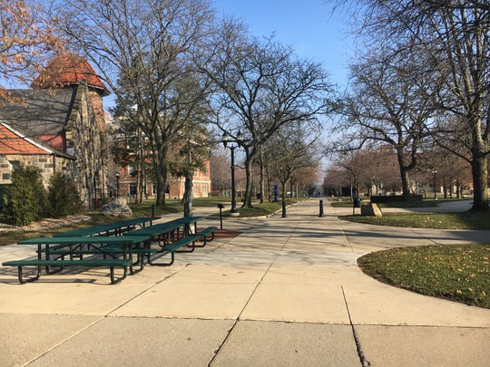 The sidewalks on Eastern Michigan University's campus are deserted.
