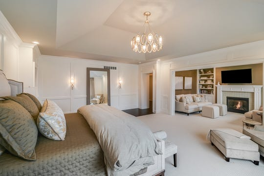 """The large owners' suite has its own sitting room, more like a living room with a fireplace. It also has two full baths and two walk-in closets. The """"hers"""" version of each is lavish."""
