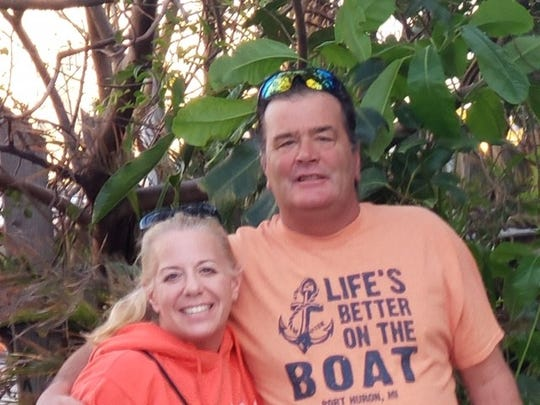 Natalie Farquhar, pictured here with husband Scott outside Le Tub Saloon in Hollywood, Fla., in January, was sent home from work at the Fiat Chrysler parts distribution center in Center Line. She was told the company needed to deep clean after a worker tested positive for coronavirus.