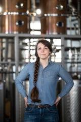 Alyssa Hughes, head distiller of Ann Arbor Distilling Company poses for a photo in the distillery in downtown Ann Arbor on March 25, 2020.