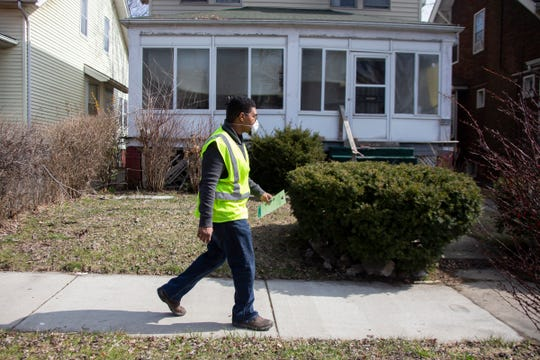 Kirk Myers, 32, of Detroit prepares to leaflet a house on Seminole on Detroit's Eastside with a recorded water shutoff. The Detroit Water and Sewage Department is restoring any such shutoffs on March 25, 2020, due to the Novel Coronavirus outbreak.