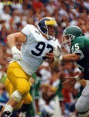 Michigan's Chris Hutchinson was Big Ten Defensive Lineman of the Year in 1992.