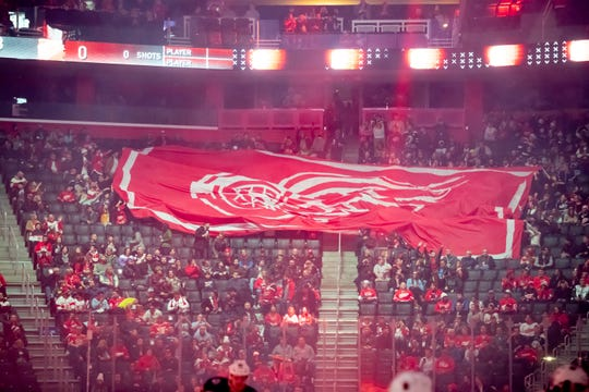 A large flag is pulled across the arena by the fans during the pregame ceremony of a Red Wings game vs. Columbus in December.