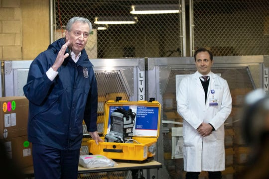 New York City Mayor Bill de Blasio, left, discusses the arrival of a shipment of 400 ventilators with Dr. Steven Pulitzer, the Chief Medical Officer of NYC Health and Hospitals, at the city's Emergency Management Warehouse, Tuesday, March 24, 2020, in New York.