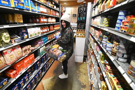 Aleksandra Dragovic of Grosse Pointe has plenty of choices during her grocery shopping at Fresh Farms Market in Grosse Pointe. The neighborhood market is fully stocked with essential items.