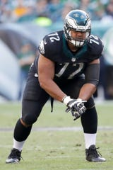 New Lions offensive tackle Halapoulivaati Vaitai signed a five-year $45 million contract as a free agent.