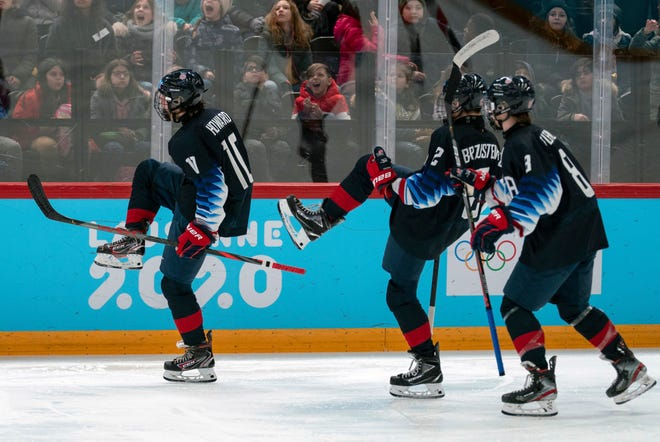 Washington Township's Hunter Brzustewicz, center, celebrates with Isaac Howard, left, and Maddox Fleming during a semifinal game against Canada at the 2020 Winter Youth Olympic Games in Lausanne, Switzerland. (Joe Toth for OIS via AP)