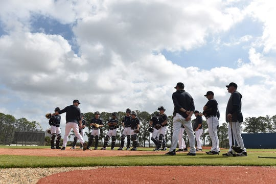 Tigers pitchers and catchers begin a workout in Lakeland, Fla., last month, before spring training was canceled.