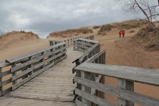Sleeping Bear Dunes on Lake Michigan is seen in this May 7, 2014, file photo. Sleeping Bear Dunes National Lakeshore has closed all of its restrooms after vandals ransacked them and made off with toilet paper and hand sanitizer.