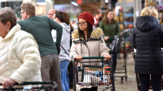 Kiara Clark, of Detroit, shops near the fresh-meat counter at the Village Market in Grosse Pointe Farms.