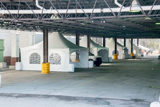 Tents are assembled next to the Fieldhouse at the old Michigan State Fairgrounds, in Detroit March 25, 2020. A coalition of local hospitals, counties, and the city of Detroit are creating a testing center for the coronavirus at the fairgrounds.