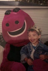 Nolan Bianchi is kind enough to pose for a picture with Barney. Lucky Barney.