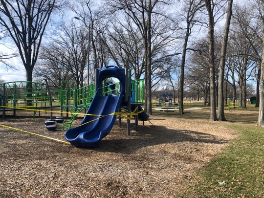 Playground equipment is taped off, but walking trails, the basketball court and other elements of Harding Park in Ferndale are open to the public during the stay-at-home order.