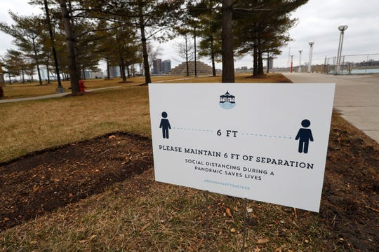 A social distancing sign on the riverfront in Detroit.