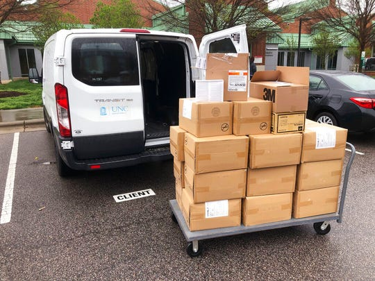 In this March 23, 2020, photo, provided by Dr. Steven Marks, medical equipment and supplies from the North Carolina State University College of Veterinary Medicine in Raleigh, N.C., await transfer to area hospitals.