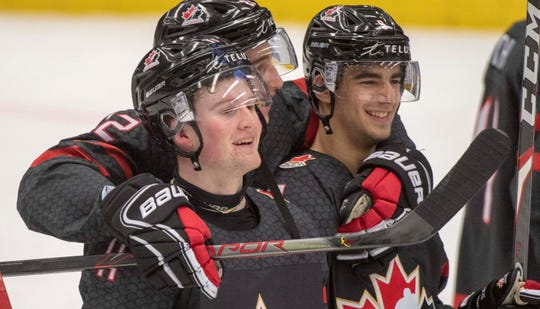 Canada's Alexis Lafreniere, left, Dylan Cozens, center, and Joe Veleno, right, celebrate after defeating Slovakia 6-1 at the World Junior Hockey Championships in January in Ostrava, Czech Republic.