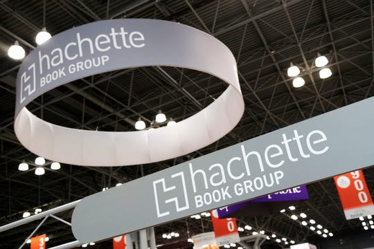 FILE - This May 28, 2015 file photo shows signs for Hachette Book Group displayed at BookExpo America in New York. an, File)