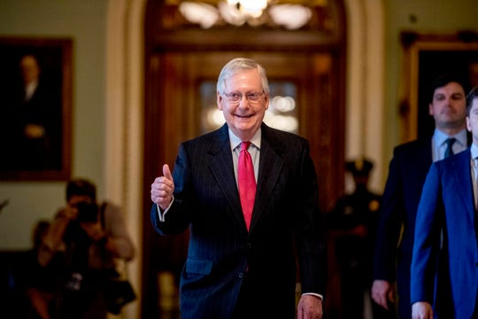 Senate Majority Leader Mitch McConnell gives a thumbs up as he leaves the Senate chamber on Capitol Hill in Washington, where a deal has been reached on a coronavirus bill.