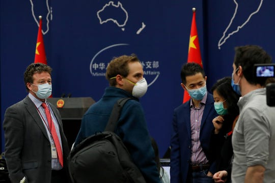 The New York Times Beijing based correspondent Steven Lee Myers, left, chats with other foreign journalists after attending a daily briefing by Chinese Foreign Ministry spokesman Geng Shuang at the Ministry of Foreign Affairs office in Beijing, Wednesday, March 18, 2020.