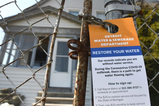A service notice from the Detroit Water and Sewerage Department is left at a home on Lillibridge Street in Detroit, Wednesday, March 25, 2020.