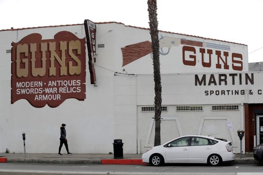 Guns are advertised for sale at a gun shop Tuesday, March 24, 2020, in Culver City, Calif.
