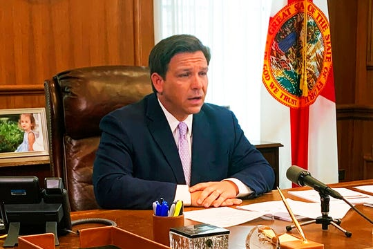 Florida Gov. Ron DeSantis updates media in the state's response to the coronavirus in Tuesday, March, 24, 2020 in Tallahassee, Fla. DeSantis has refused to follow the lead of other states that have issued broad shutdowns to control the spread of the coronavirus, instead shifting the onus to outside travelers whom he blames for bringing COVID-19 into Florida.