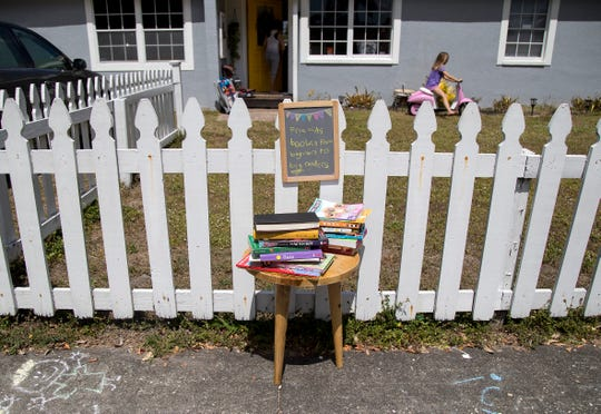 The Copeland family put out free kids books on the sidewalk in front of their Fort Myers home on Tuesday, March 24, 2020, after seeing another family had done the same thing in their neighborhood.
