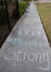 Inspirational messages are written on the sidewalk in the Jefferson Park neighborhood in Fort Myers. Other nearby neighbors also participated, adding chalk art so people on walks could see the messages and artwork.