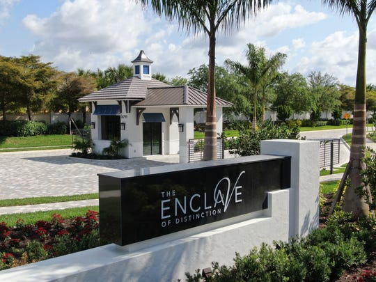 A guardhouse at The Enclave of Distinction is functional as a live person monitored gate house or a fully automated guardless entry.