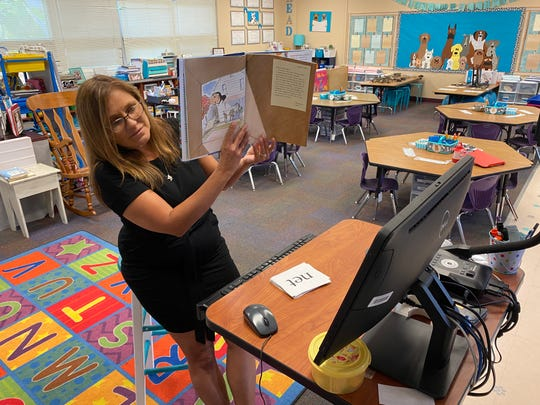 Kindergarten trainer Marylin Prysi reads to her college students on Zoom on Tuesday, March 24, 2020, at Villas Fundamental Faculty in Fortress Myers. She acknowledged her college students began reaching out to her, so she enlighten up Zoom conferences to study on them.