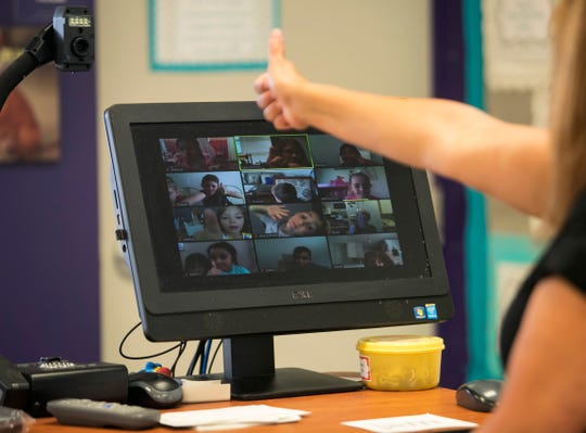 Kindergarten teacher Marylin Prysi checks in with her students on Zoom on Tuesday, March 24, 2020, at Villas Elementary School in Fort Myers. She said her students began reaching out to her, so she set up Zoom meetings to check on them.