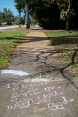 ÒDo not fear for I am with you- GodÓ is one of several messages on the sidewalk along Braman Avenue in Fort Myers.
