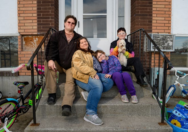 Karl and Barbara Stanford with their children Serenity Moseley, age 8, and Ryan Stanford, age 13, and their dog Boomer are spending a lot more time together since the coronavirus social distancing guidelines went into effect.  Barbara wanted to return to work but with schools closing she now has to stay home with Serenity.