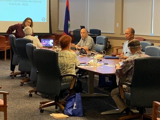 The Consolidated Commission on Utilities and managers from the island's power agency gather in a conference room March 24 at the Gloria B. Nelson Public Service Building. The conference room was closed to the public for the CCU meeting, but chairs were set up aside the room, where a live feed of the meeting was displayed on a screen.