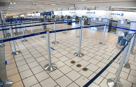 Stanchions normally used to manage a crowd of travelers departing on United Airlines flights, at the A.B. Won Pat International Airport in Tamuning, are found void of passengers during a midday visit on Wednesday, March 25, 2020.
