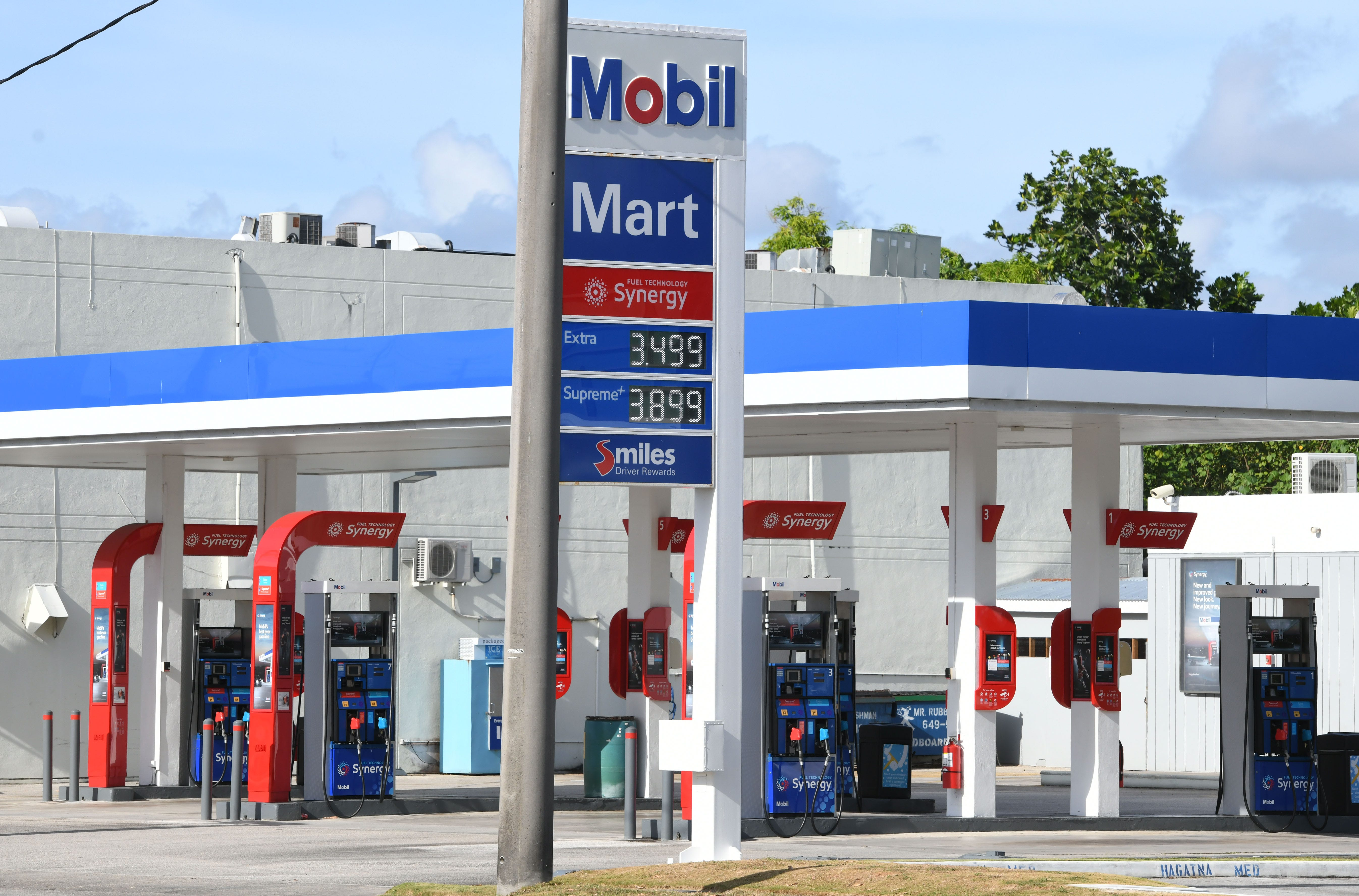 A sign at a Mobil gas station along Route 4 in Hagåtña reflects a reduction of twenty-cents in fuels price on Wednesday, March 25, 2020.