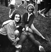 This Gleaner file photo depicts Vivian Baxter,  a student at Henderson County High School,  tagging her catch during the school's 1965 observance of Sadie Hawkins Day with some help from Judy Miller. The cultural phenomenon dates from 1937 and Barret Manual Training High School had a dance April 6, 1945. The Gleaner's story at that time indicated local Sadie Hawkins dances predated 1945. (Photo courtesy Henderson County Public Library)