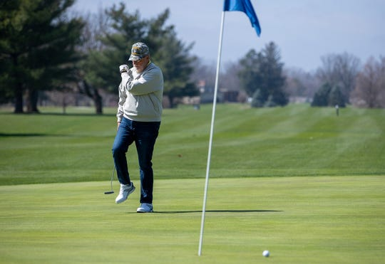 A golfer reacts after missing a long putt at Sarah Shank Golf Cours in Indianapolis on Wednesday, March 25, 2020.