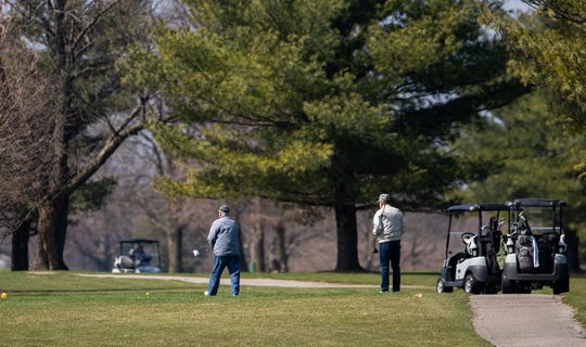 Golfers enjoy a sunny day at Sarah Shank Golf Cours in Indianapolis on Wednesday, March 25, 2020.