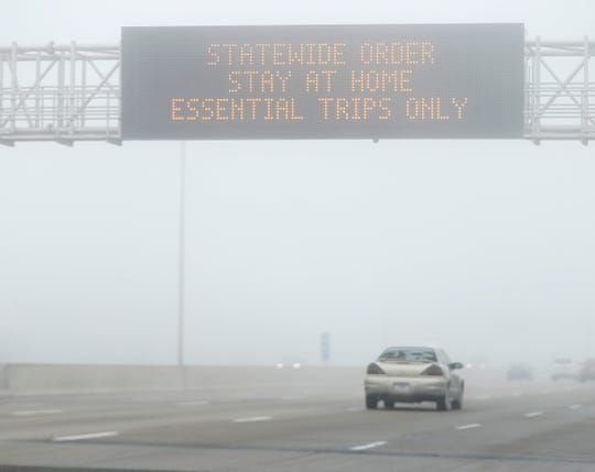 A sign over 465 on the north side of Indianapolis reminds people of the stay at home statewide order, Wednesday, March 25, 2020.