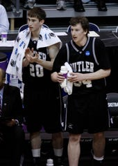 Butler's Gordon Hayward, left, and Matt Howard, right, cheer from the bench in the first half of an NCAA West Regional semifinal college basketball game in Salt Lake City, Thursday, March 25, 2010.