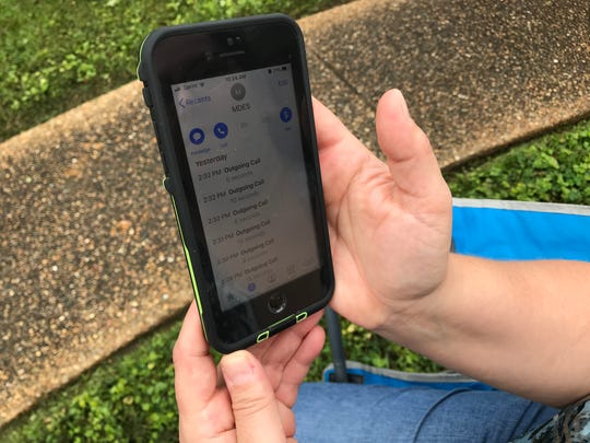Clinton resident Darla Kemmerer displays the call log on her cell phone on Wednesday morning. She and neighbor, Belinda Woods-Johnson, have made repeated attempts, on Woods-Johnson's behalf, to get through the busy unemployment phone line. Wednesday, March 25, 2020.