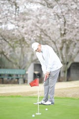Wiley Jones putts on a green at Three Ridges Golf Course in Knoxville, Tennessee on Wednesday, March 25, 2020. The golf course has implemented measures such as leaving flagsticks in the cups, one adult rider per golf cart, and avoid gathering inside the clubhouse.