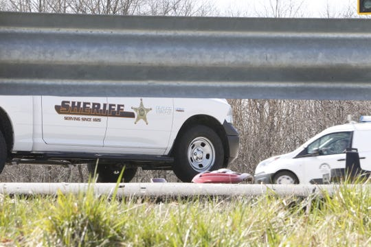 Debris from a pickup truck litter the intersection of U.S. 231 and Veterans Memorial Parkway where deputies are investigating the fatal accident that killed the truck's driver.
