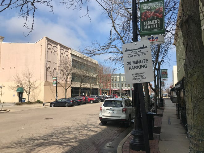 Lafayette installed its first 20-minute parking zones for restaurants carry-out in downtown on Wednesday, March 25, 2020. City officials said the signs were an effort to help restaurants trying to stay in business during the dining restrictions imposed during the coronavirus pandemic. This sign is outside Revolution Bakery on Fifth Street.