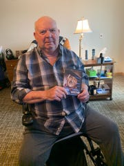 Glenn Thomas holds a collection of his favorite movies featuring John Wayne while the Primrose Retirement Community he lives in follows guidelines from the state limiting interaction among residents and visitors during the ongoing coronavirus pandemic. Several senior care facilities are limiting visitors to their buildings and are following strict screening protocols.