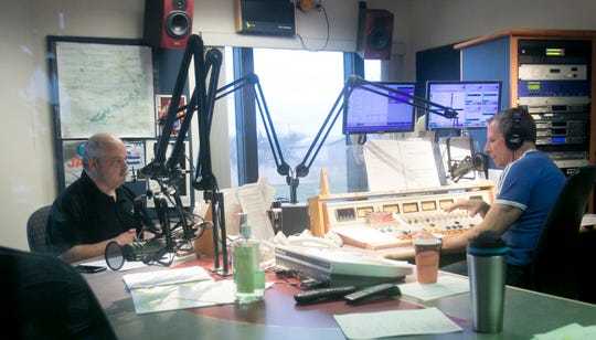 "WHMI ""Mike & Jon in the Morning Show"" hosts News Director Jon King, left, and Mike Marino field questions from callers in a radio town hall meeting hosted by the radio station Wednesday, March 25, 2020."
