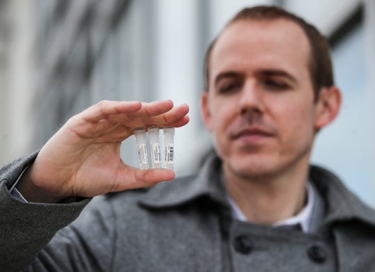 James Corne, director of marketing at Eurofins Genomics LLC, holds a sample of test kit materials produced at their Jeffersontown facility. The company has seen an increase from private labs that purchase synthetic DNA that is used to test for the coronavirus.
