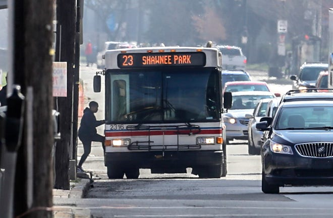 Riders board a TARC bus on West Broadway on Wednesday, Mar 25, 2020.